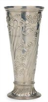 AN AMERICAN SILVER TRUMPET VASE REPOUSSE WITH FLOWERS,