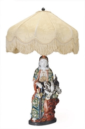 A JAPANESE PORCELAIN FIGURE OF