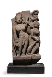 AN INDIAN RED SANDSTONE FIGURE
