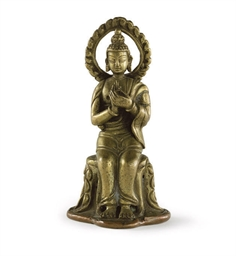 A SMALL INDIAN GILT COPPER FIG