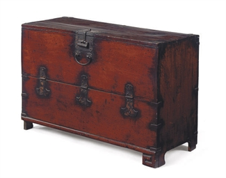 A METAL-BOUND HARDWOOD CHEST,