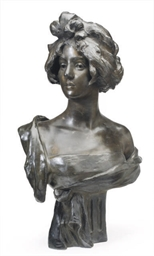 A PATINATED BRONZE BUST OF A W