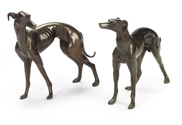 A PAIR OF PATINATED BRONZE HOU