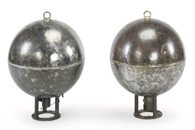A PAIR OF POLISHED IRON INDUST