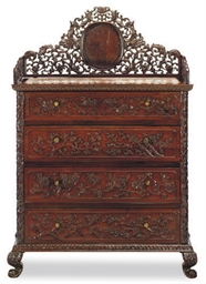 A HARDWOOD CHEST-OF-DRAWERS,