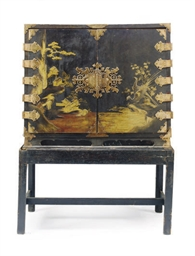 A BLACK LACQUERED AND GILT-DEC