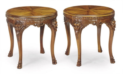 A PAIR OF CARVED WALNUT CIRCUL