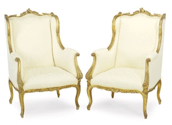 A NEAR PAIR OF FRENCH GILTWOOD