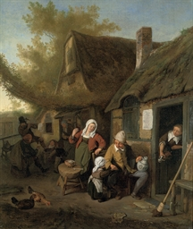 A peasant family outside a cot