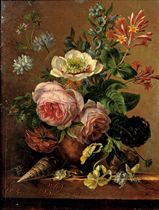 An exuberant flower still life on a marble ledge