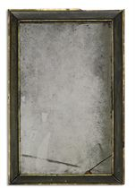 A QUEEN ANNE PARCEL-GILT EBONISED MIRROR