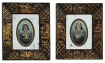 A PAIR OF REGENCY REVERSE-PAINTED MIRROR PORTRAITS