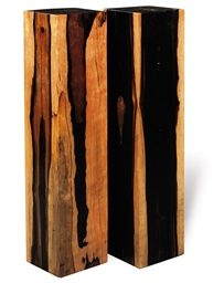 A PAIR OF EBONY PEDESTALS