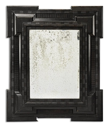 AN ANTIQUARIAN EBONISED MIRROR