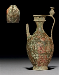 AN EARLY ISLAMIC BRONZE EWER