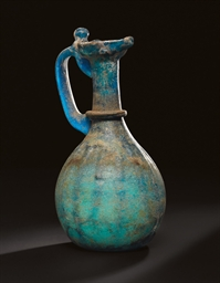 AN UMAYYAD BLUE GLASS EWER