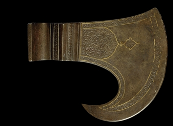 A SAFAVID CARVED STEEL AXE-HEA