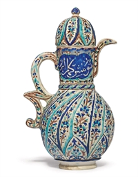 A KUTAHYA POTTERY EWER AND COV