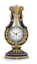 AN ORMOLU-MOUNTED SEVRES STYLE 'JEWELED' LYRE-FORM MANTEL CL