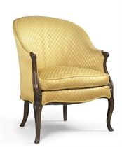 A GEORGE III STAINED BEECH BERGERE