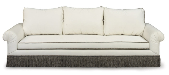 A CREAM-UPHOLSTERED SOFA
