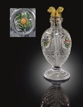 A BACCARAT CUT-GLASS DIVIDED SCENT BOTTLE AND FOUR ORMOLU STOPPERS