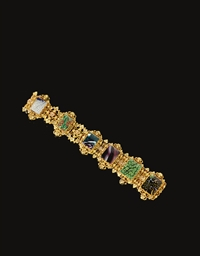 A GOLD BRACELET SET WITH MOSAI