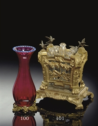 A FRENCH ORMOLU AND GLASS POSY
