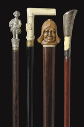 A GROUP OF FOUR WALKING STICKS