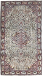A LARGE TABRIZ CARPET