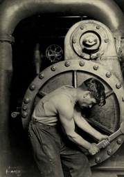 Mechanic at steam pump in elec