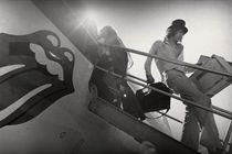 Mick Jagger disembarking from plane, c. 1972