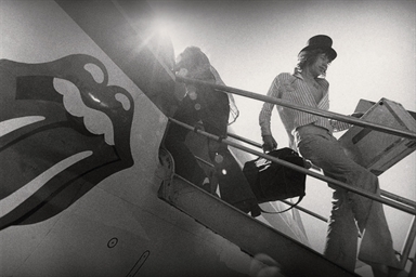 Mick Jagger disembarking from