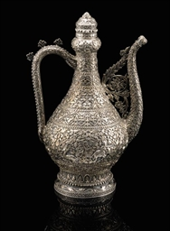 A FINELY CHASED SILVER EWER, M
