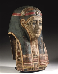 AN EGYPTIAN PAINTED AND GILDED