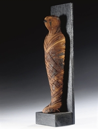 AN EGYPTIAN MUMMIFIED FALCON