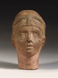 A GRAECO-ROMAN TERRACOTTA HEAD