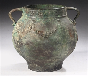 A ROMAN BRONZE TWIN-HANDLED CA