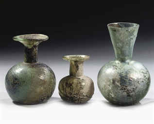 THREE ROMAN GREEN GLASS VESSEL
