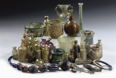 A GROUP OF GLASS VESSELS