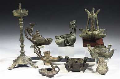 A GROUP OF BRONZE LAMPS