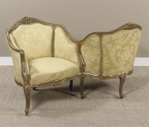 A FRENCH GILTWOOD CONFIDENT