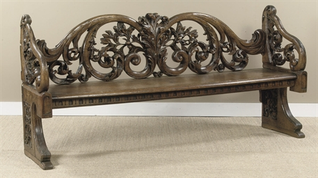 A DUTCH CARVED OAK HALL BENCH