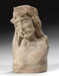 A TERRACOTTA HALF FIGURE OF TH