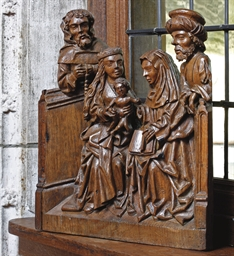 A CARVED OAK RELIEF OF ANNA SE