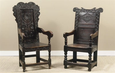 TWO CARVED OAK ARMCHAIRS