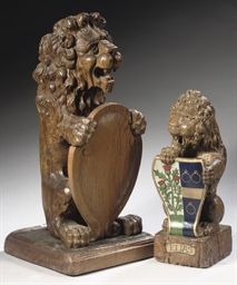 TWO CARVED OAK CARTOUCHE BEARI