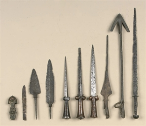 A GROUP OF TEN AGED WEAPONS IN