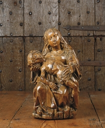 A CARVED OAK GROUP DEPICTING T