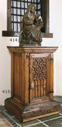 A CARVED OAK FIGURE OF ST ANNE